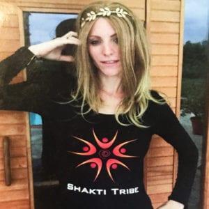 A model wears a Shakti Tribe Shirt, long sleeve black with logo