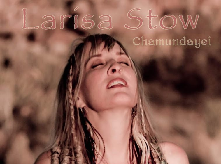 Larisa Stow radiates bliss in the ecstasy of chanting mantra.