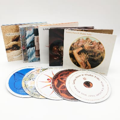 A collection of five music compact discs from Larisa Stow